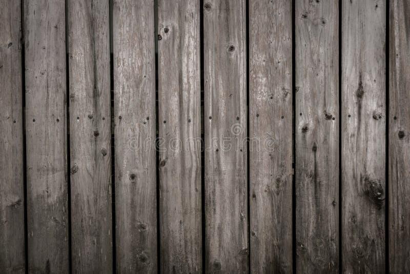 Rustikaler hölzerner grauer Zaunhintergrund stockfotos