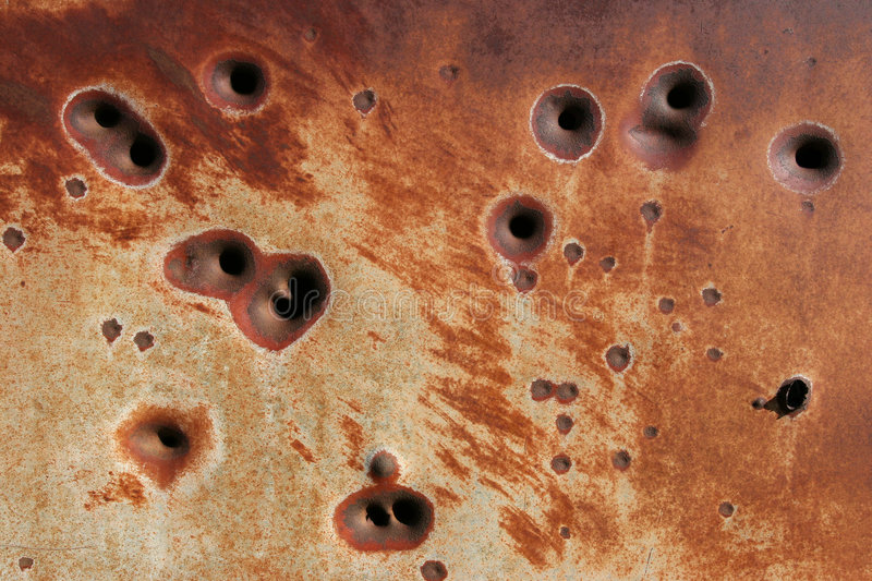 Rusting bullet holes background royalty free stock photo