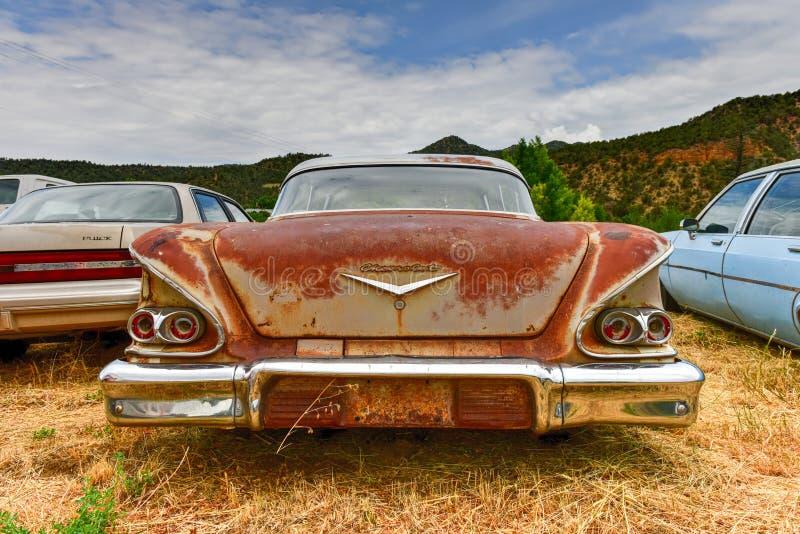 Rusting Car in Junk Yard royalty free stock image