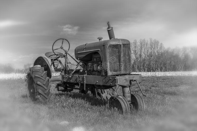 Rusting derelict tractor in rural area. stock image