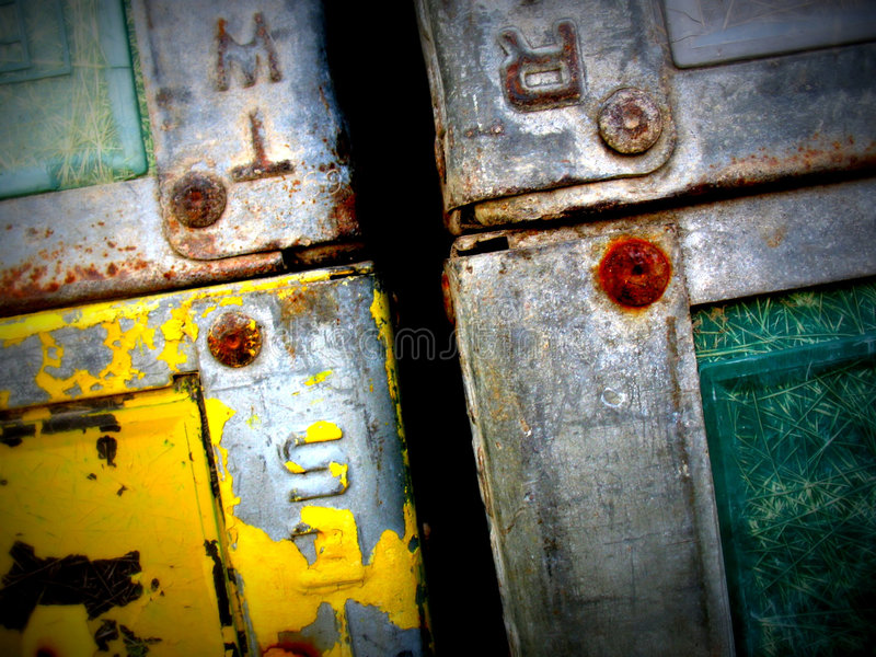 Rusting Metal Cases. Old metal trunks rusting and stacked on top of each other royalty free stock images
