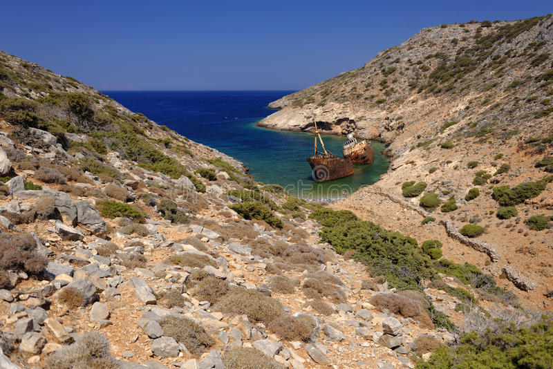 Rusting shipwreck in Amorgos stock image
