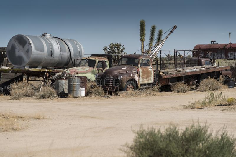 Rusting trucks and other stuff at Cima Station Mojave Preserve. Cima is a small unincorporated community in the Mojave Desert of San Bernardino County royalty free stock photos
