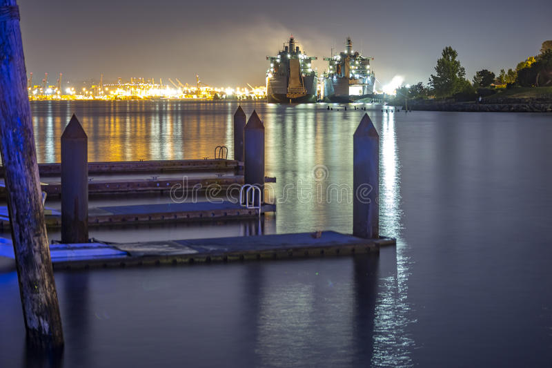Ruston Park Boats from the docks in Washington state USA. The bay in Tacoma Washington at sunset and into nightfall royalty free stock photo