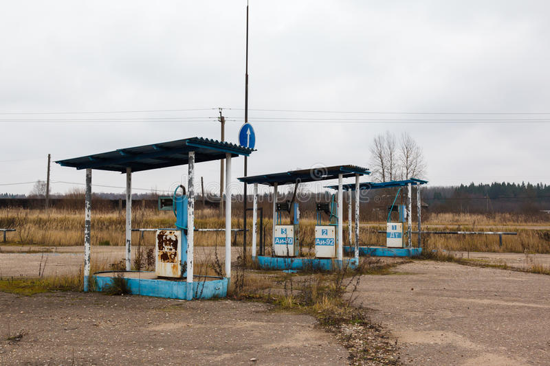 Rusty abandoned pump. On the gas station at autumn day in Russia stock image