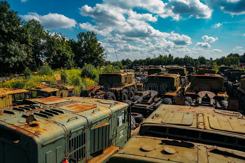 Rusty abandoned Russian military cars for scrap metal stock photography