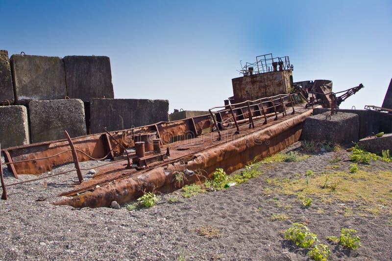Rusty abandoned shipwreck on the beach in Sukhum, Abkhazia. Georgia stock photos