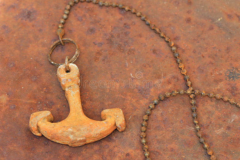 Rusty anchor and chain. Old weathered rusty anchor and chain stock images