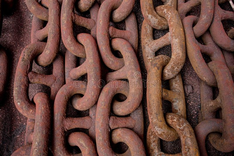 Rusty chain on the floor. Rusty anchor chain put on the floor and have grit blasting media royalty free stock images