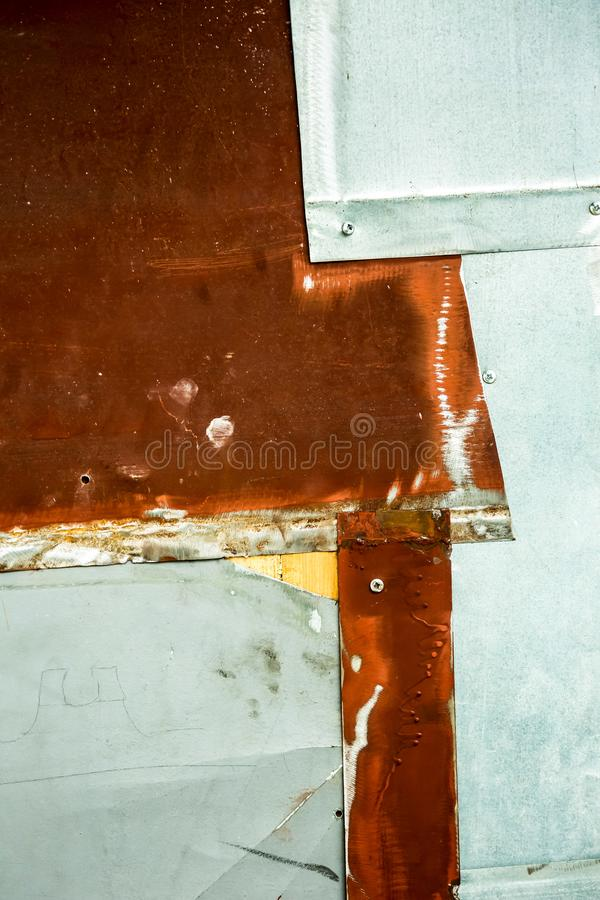 Rusty background 2 old doors. Rusty metal background. bits bolted across, part of old doors royalty free stock images