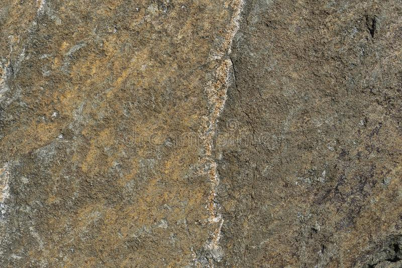 Rusty background. The surface of the marble with a brown tint. Grunge abstract stone royalty free stock photo