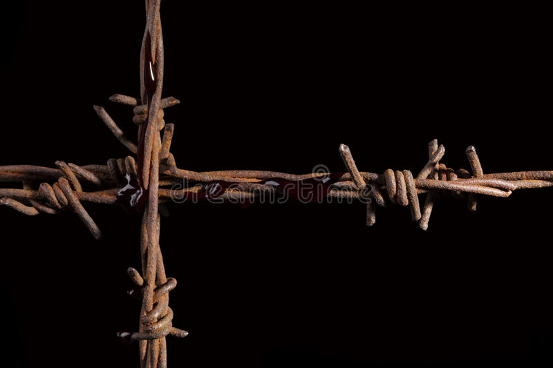 Rusty barb wire cross. stock photography