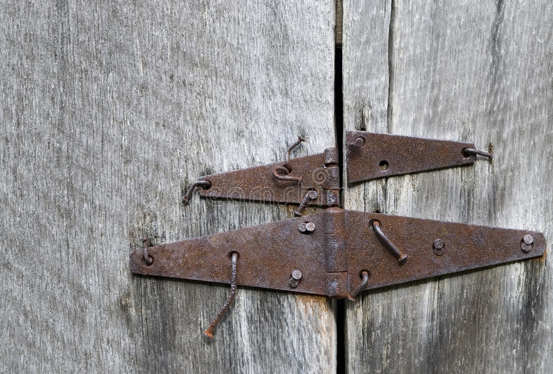 Rusty barn door hinges and bent nails on ancient oak lumber, Parker-Hickman Homestead, Buffalo National River, Arkansas royalty free stock images