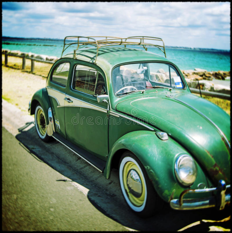 Rusty Beetle by the sea. An image of a rusty old Beetle manipulated to create the feel of mobile phone app on a beach in Sydney Australia. Copyspace