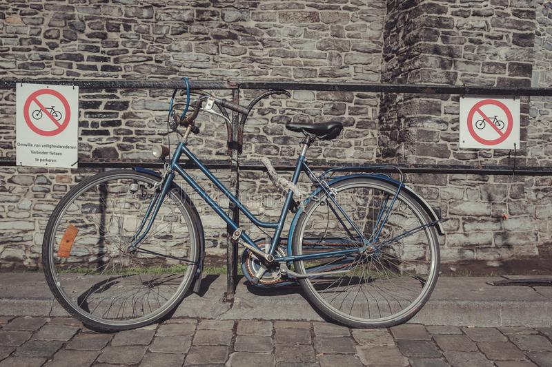 Parked bike ignores parking prohibition signs royalty free stock photography