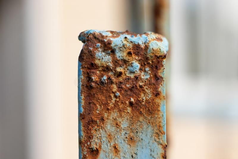 Rusty blue post in details stock photos
