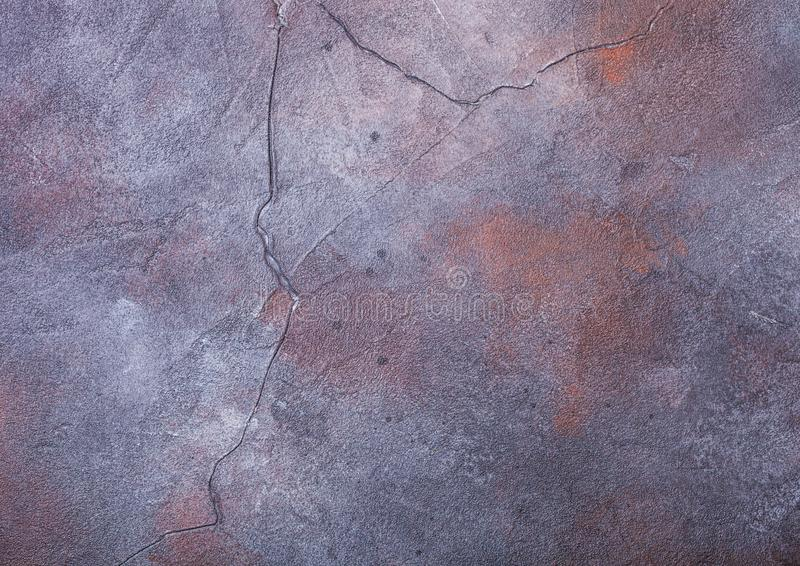 Rusty blue purple cement concrete stone texture with cracks royalty free stock images
