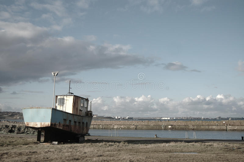 Rusty Boat and Harbour royalty free stock photography