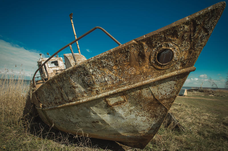 Rusty boat. Old rusty abandonment fishing boat stock photo