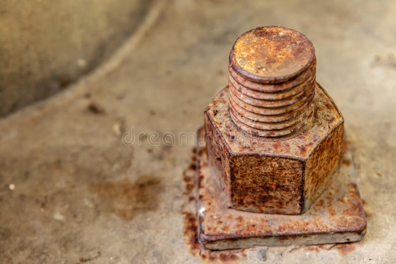 Rusty bolt and nut on concrete. Rusty bolt and nut on concrete background royalty free stock photos
