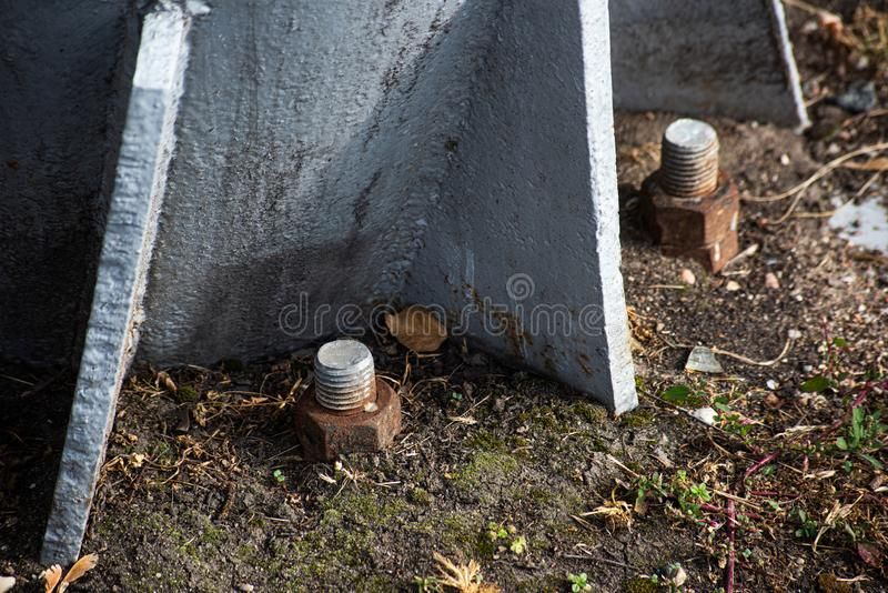 Rusty bolts with nuts on a metal support royalty free stock photos