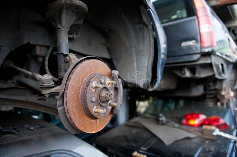 Rusty brake disc on scrap yard. Rusty brake disc with internal cooling on demolished car on scrap yard stock photo