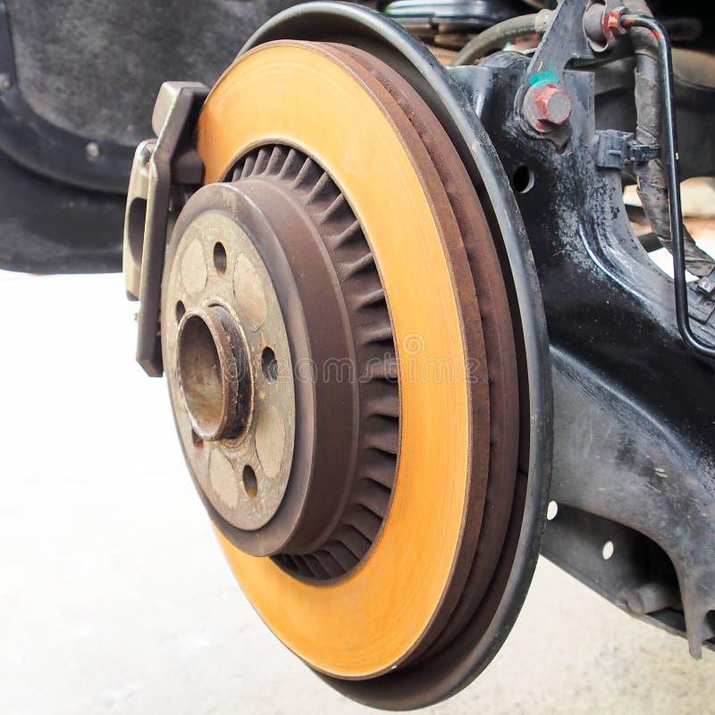 Rusty brake disc of rear wheel. Rusty brake disc of luxury car rear wheel stock photo