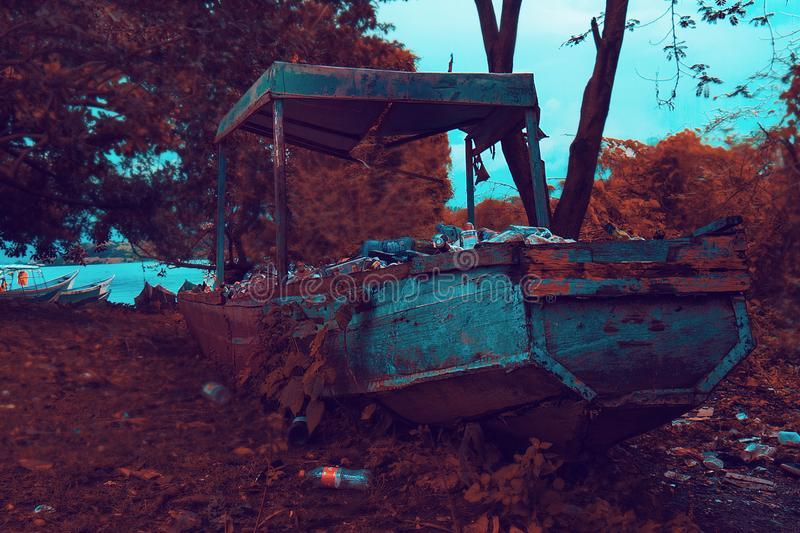 Rusty Brown and Gray Boat Near Trees and Body of Water stock photos