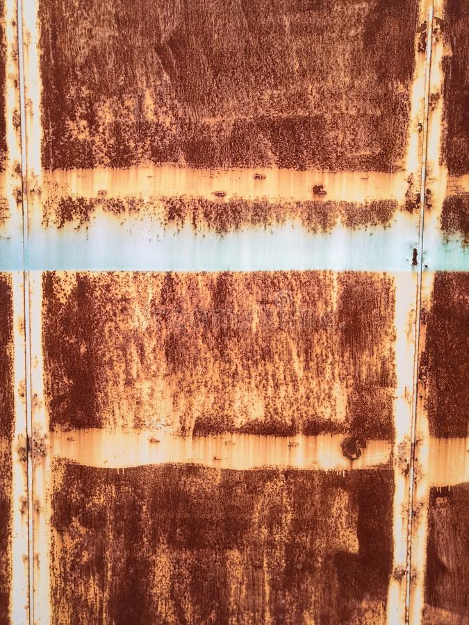 Rusty brown metal wall with yellow patterns. metal rust texture background royalty free stock images