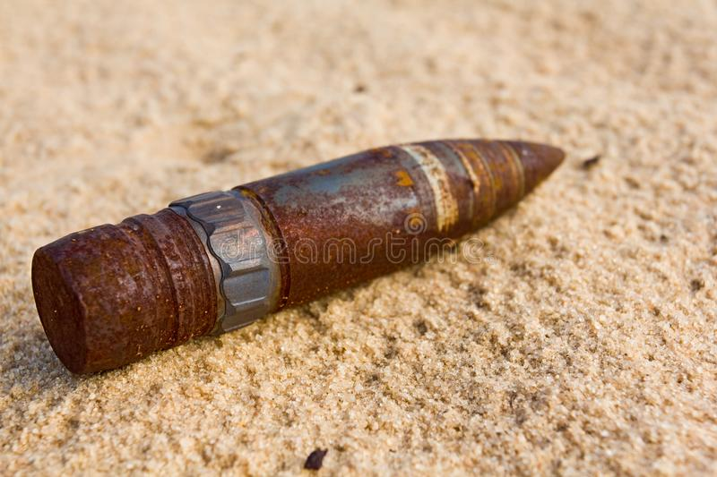 Rusty bullet on a sand stock photos