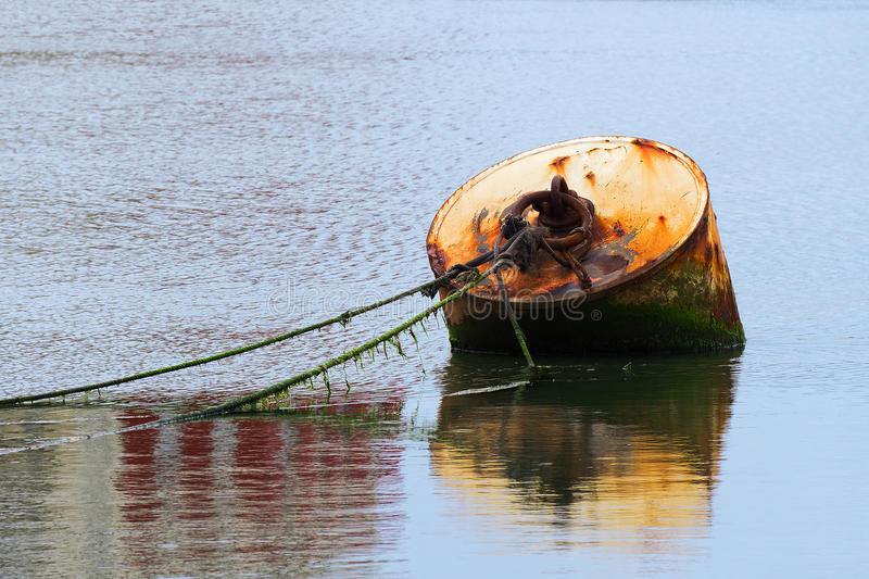 Rusty buoy with ropes stock images