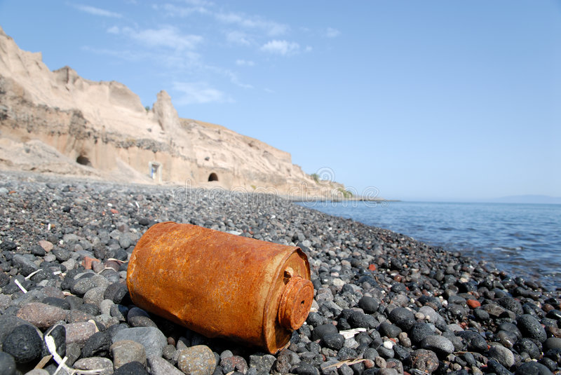 Rusty can on the beach royalty free stock images