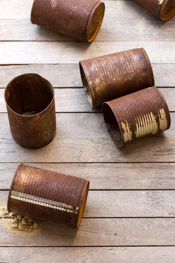 The rusty cans on slat.  royalty free stock image