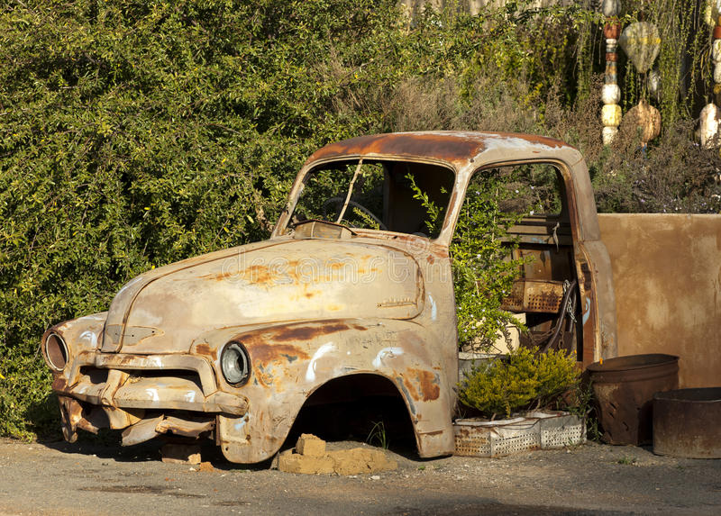 Rusty car. Body of a Rusty car in the street stock image
