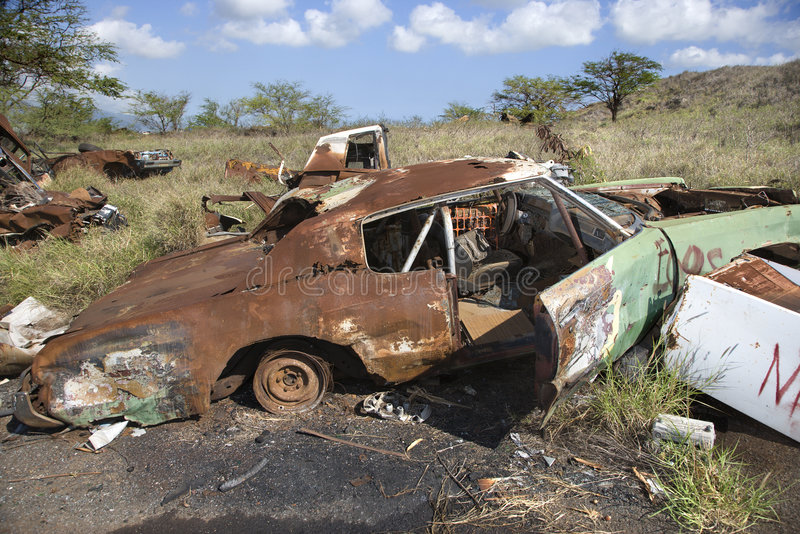 Rusty car in junkyard. Old rusted car in junkyard stock photos