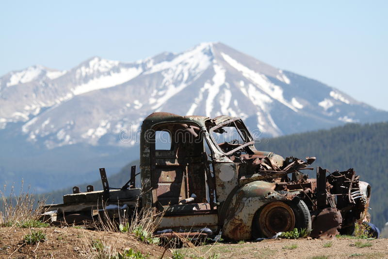 Rusty car remains in Rocky Mountains royalty free stock images