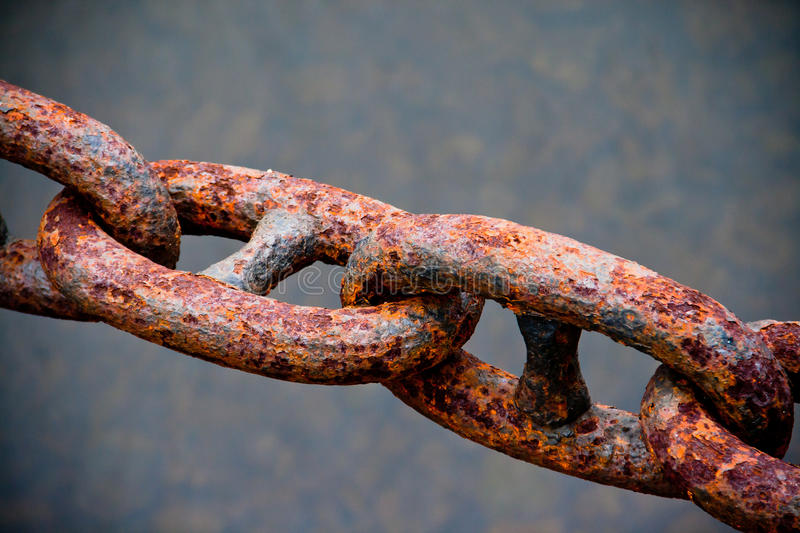 Rusty chain. A macro of a rusty chain stock photos
