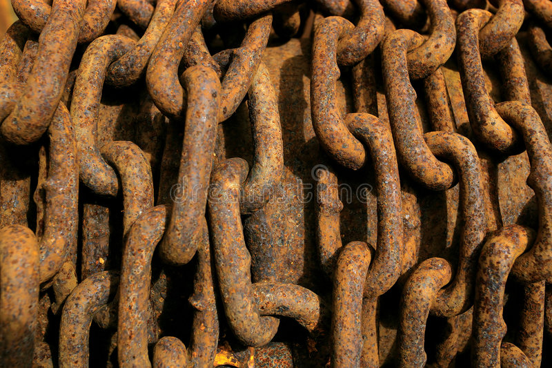 Rusty chain. Background image of a rusty pile of chain royalty free stock photography