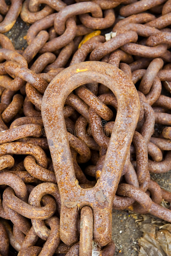 Rusty chain. Close-up of a rusty iron chain in IJmuiden harbor stock images