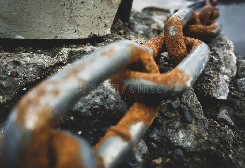 Rusty chain. Abstract picture rusty chain on rock royalty free stock images