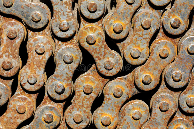 Rusty chain from bicycle. Old rusty chain from the bicycle closeup stock image