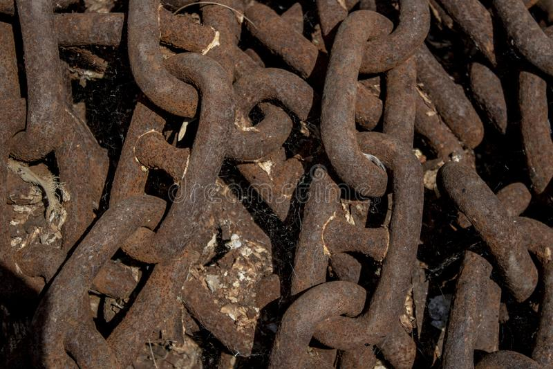 Rusty chain. Close-up photo. Marine equipment, metal, background, texture, iron, industrial, closeup, strength, industry, old, brown, material, steel, strong stock photos