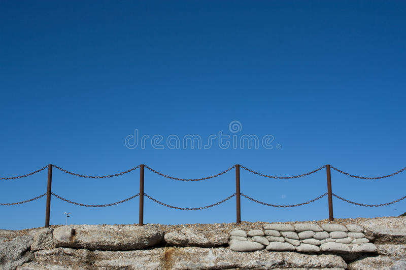 Rusty chain fence on Hastings beach. England royalty free stock image