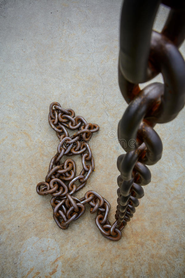 Rusty chain on floor. With vignette royalty free stock image