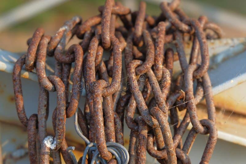 Rusty chain on gate closeup. Rusty chain on abandoned place gate closeup stock image