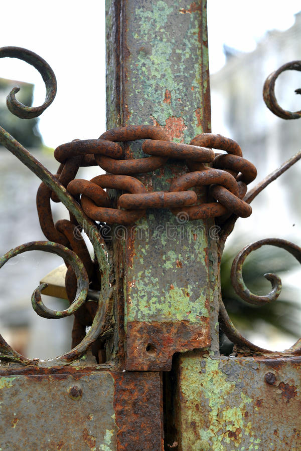 Rusty chain and gate. A closeup of a rusty chain wrapped around a rusty gate royalty free stock photography