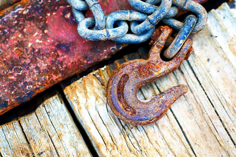 Rusty Chain and Hook. Details of a chain used in the offshore oil and gas industry royalty free stock image
