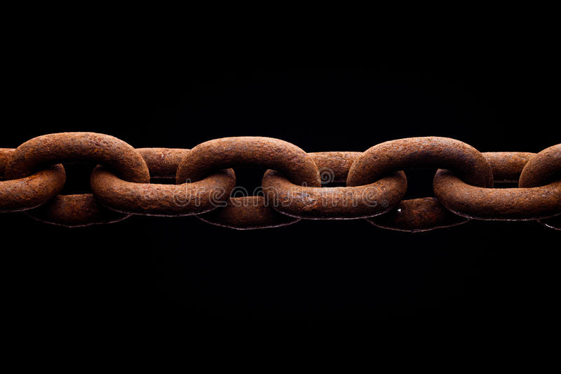 Rusty chain isolated on black background stock photos
