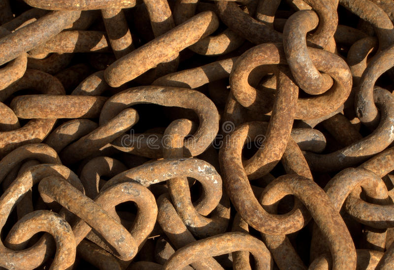 Rusty chain links. Background of rusty chain links stock photo