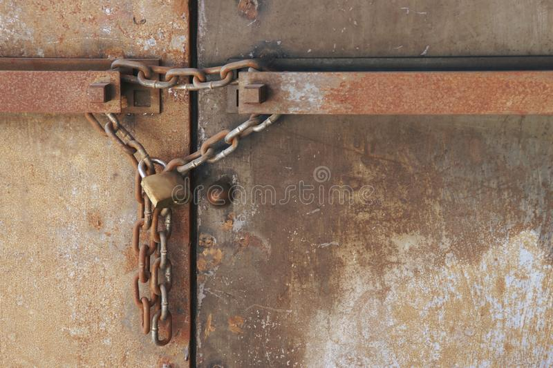 Rusty Chain with Lock on Metal Double Doors. Rusty Chain with Lock on old Metal Double Doors royalty free stock images